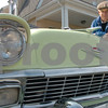 "Peabody:<br /> Billy Dunn is standing next to his classic 56 Chevy BelAir in his driveway. He created a street sign that says, ""Chevy St."" for his driveway because of his love of Chevys. <br /> Photo by Ken Yuszkus/Salem News, Friday, March 20, 2009."