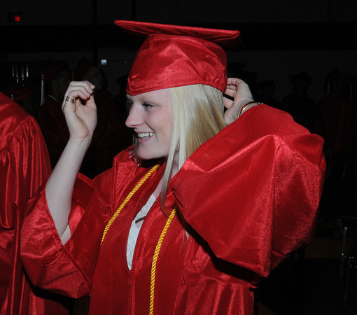 Salem:<br /> Sophie Wyke places her mortarboard on her head while lining up for the processional for the Salem High graduation.<br /> Photo by Ken Yuszkus/Salem News, Friday, June1, 2012.