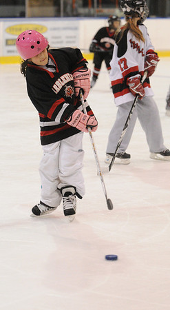 Salem:<br /> Ava Ulian, 8, practices handling the puck at the Marblehead High School girls hockey youth clinic at Salem State University. The players worked with local female youths on Thursday evening.<br /> Photo by Ken Yuszkus/Salem News, Thursday, February 24, 2011.