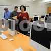 Salem:<br /> Vincent Dube, project architect, David Angeramo, principal, and Darleen Mellis, school building committee chairman, walk through a computer lab during their tour of the newly renovated Salem High School. <br /> Photo by Ken Yuszkus/Salem News, Monday September 15, 2008.