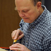 Danvers:<br /> Howard Reynolds, of Danvers, carves his project during the wood carving class at the Danvers Council on Aging.<br /> Photo by Ken Yuszkus/Salem News, Friday, January 13, 2012.