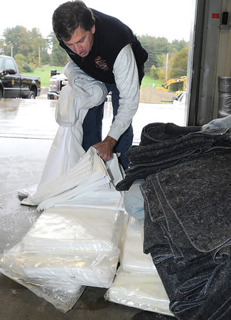 Middleton:<br /> Mark Brings sorts through sheets that he, his wife, Janet, and daughter, Erin, brought as well as blankets to the Middleton Jail to be washed before sending them to an orphanage in Afghanistan.<br /> Photo by Ken Yuszkus/Salem News, Wednesday, October 19, 2011.