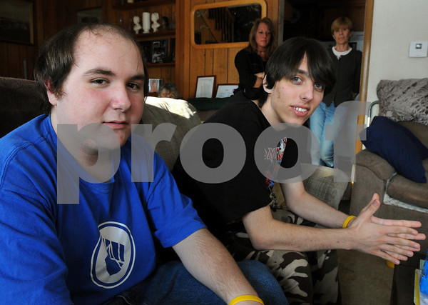 Danvers:<br /> Mike Petrosino, left, and Erik West, sit and talk as their mothers, Elaine West, left, Erik's mother, and Paula Petrosino, Mike's mother, stand in the background at the West's home. The two juniors at Beverly High School have been diagnosed with a rare cancer called Ewings Sarcoma. Mike is helping Erik get through it.<br /> Photo by Ken Yuszkus/Salem News, Friday,  January 23, 2009.