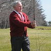 Beverly:<br /> Mayor Bill Scanlon watches the direction of his golf ball which he hit from the first tee to mark the opening of the Beverly Golf and Tennis Club under its new operator, Golf Facilities Management Inc..<br /> Photo by Ken Yuszkus/Salem News, Thursday, March 25, 2010.
