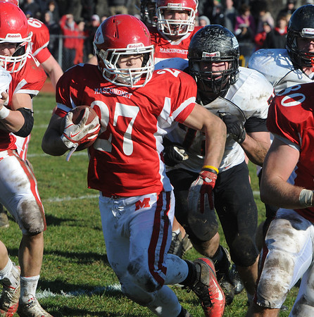 Topsfield:<br /> Masco's Mike Tivinis runs with the ball at the North Andover at Masconomet football game on Thanksgiving Day.<br /> Photo by Ken Yuszkus/Salem News, Thursday, November 24, 2011.