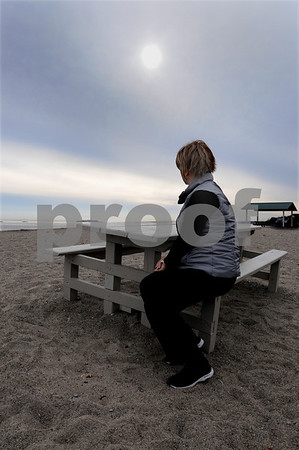 Marblehead:<br /> Beth sits at a picnic table at Deveraux Beach. Beth is a woman who has been helped by the SHE Network. Beth was diagnosed with ovarian cancer in June and supported by the SHE Network all summer, while she had chemo. The groupo, made up of women from Marblehead and Swampscott, made her meals, had her house fixed up, have moral and professional support, set up day-care and playdates, etc., to help Beth. Beth originally met the people from the SHE Network at that specific picnic table.<br /> Photo by Ken Yuszkus/Salem News, Wednesday, November 5, 2008.