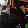 Beverly:<br /> Lyn Ego, left, cheers at the Thanksgiving Salem at Beverly football game at Hurd Stadium. Her son Alex Ego, number 51, played for Beverly. Her sister Nancy Slattery, right, is part of the large group of relatives cheering on Alex.<br /> Photo by Ken Yuszkus/Salem News, Thursday, November 25, 2010.