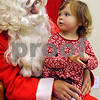 Peabody:<br /> Olivia McGrath, 2, of Peabody, sits in Santa's lap and tells him what she would like for Christmas. Santa arrived in the morning at the Breakfast With Santa at the South Branch Library.<br /> Photo by Ken Yuszkus/Salem News, Wednesday December 10, 2008.