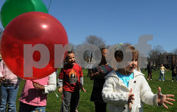 Salem:<br /> From left, Kevin Mendez, Brihanna Parker, and Caitlyn Nims watch as their balloons fly away after releasing them at the Salem Common. Seven balloons, one representing each classroom of the Salem Community Child Care, were released as part of their celebration of The Week of the Young Child April 19-25.<br /> Photo by Ken Yuszkus/Salem News, Friday, April 24, 2009.