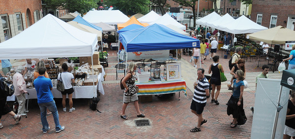 Salem:<br /> People walk amongst the vendor's stands at the Salem Farmers Market.<br /> Photo by Ken Yuszkus/Salem News, Thursday, July 5,  2012.