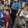 "Salem:<br /> Mass. state trooper Katy Downey, center, sings ""Proud To Be An American"" with Elisa LaSota's first grade class at the Horace Mann Laboratory School. Every year the class corresponds with a chosen hero and then meet its hero at the end of the year on the last day of school.<br /> Photo by Ken Yuszkus/Salem News, Thursday, June 23, 2011."
