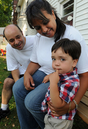 "Danvers:<br /> From left, Ron Ouimette, Isabelle, who had her boy, Andre, born with a congenital heart defect. They have gone to four hospitals trying to help the two year old boy. She is speaking out as the local president of the ""It's My Heart"" Boston Chapter. She is trying to build awareness of the problem.<br /> Photo by Ken Yuszkus/Salem News, Tuesday,  September 7, 2010."