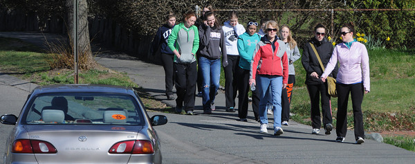 Beverly:<br /> Participants walk along Corning Street in Beverly as part of the 33rd annual Good Friday Walk, which raises money to help needy families on the North Shore.<br /> Photo by Ken Yuszkus/Salem News, Friday, April 6, 2012.