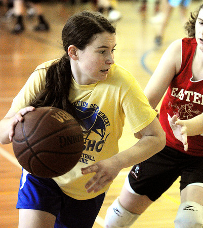 Marblehead:<br /> Olivia Comeau, from the team, Shooting Stars, makes her move at the Jimmy Myers 3-on-3 Basketball Tournament held at the JCC of the North Shore.<br /> Photo by Ken Yuszkus/Salem News, Monday, January 16, 2012.