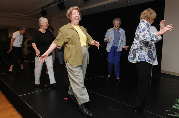 Peabody:<br /> From left, Jackie Kusch, Joanne Avery, Sonia Sternberger, and Natalie Goodwin practice dance steps along with the other residents in preparation for the upcoming 10-year anniversary festivities this week.<br /> Photo by Ken Yuszkus/Salem News, Tuesday, June 1, 2010.