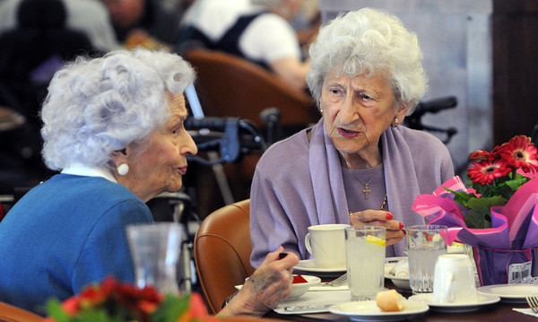 Beverly:<br /> Alice ( Lowe is her maiden name ) Caron, left, and Georgie ( Mirageos is her maiden name ) Mahos talk at a 1937 class reunion of graduates from Peabody High School.<br /> Photo by Ken Yuszkus/Salem News, Tuesday, April 17, 2012.