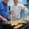 Danvers:<br /> Alan Hartnett, left, and John Call, of The Kiwanis Club, cook up chicken kabobs on the gill at the Danvers Family Festival Senior Citizen Lunch held at the Danvers Senior Center.<br /> Photo by Ken Yuszkus/Salem News, Tuesday, June 26, 2012.