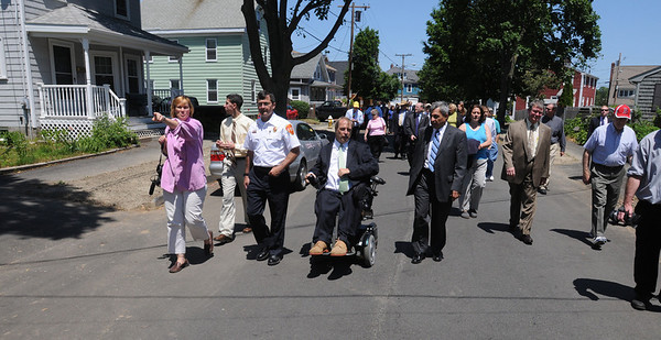 Danvers:<br /> The group walks on Riverside Street as they tour the neighborhood affected by the Danversport explosion.<br /> Photo by Ken Yuszkus/Salem News, Monday, June 6, 2011.