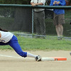 Danvers:<br /> Danvers' first baseman, Alicea Dean, gets the throw to get North Reading's Terri Ferrazzani out during the North Reading at Danvers Division 2 North first round state tournament game.<br /> Photo by Ken Yuszkus/Salem News, Thursday, June 2, 2011.