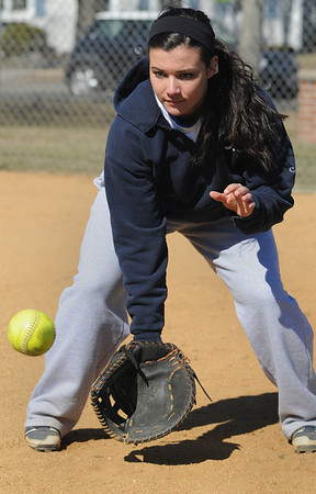 Danvers:<br /> Alicia Dean warms up during the Danvers High softball practice at Great Oak School field.<br /> Photo by Ken Yuszkus/Salem News, Monday, March 28, 2011.