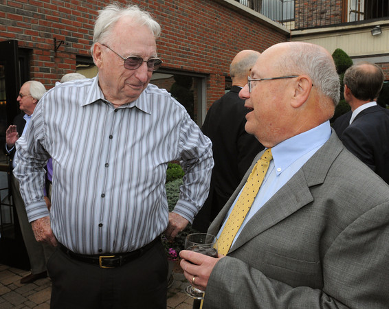 """Danvers:<br /> William """"Bill"""" Coughlin, left, former Beverly council at large, and Nelson Benton talk at Nelson Benton's retirement party which was held at the Danvers Yatch Club.<br /> Photo by Ken Yuszkus/Salem News, Wednesday, June 27,  2012."""