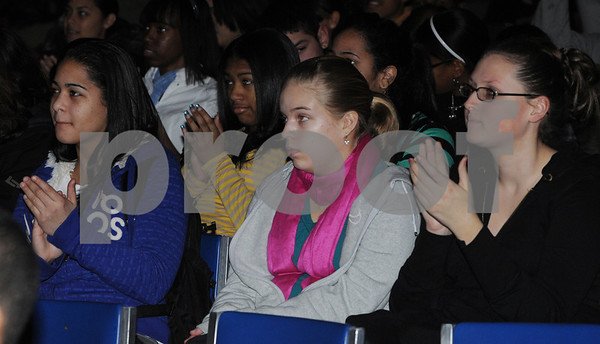 Salem:<br /> From left, Stephanie Garcia, a junior, Meghan Debski, a sophmore, and Brianna Cruddas, a junior, react at the end of president Obama's inaugural speech during the inauguration which was shown on a large projection tv screen at the Salem High School auditorium.<br /> Photo by Ken Yuszkus/Salem News, Monday,  January 20, 2009.