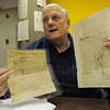Danvers:<br /> Richard Trask holds three old documents. Two are 1688 and 1689 arrest warrants, left, and the other is a 1719 deed. They were looted from Virginia during the Civil War.<br /> Photo by Ken Yuszkus/Salem News, Monday, April 23, 2012.