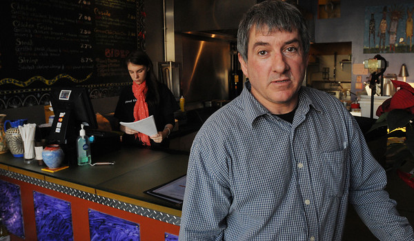 Salem:<br /> Pat Schultz, owner of Howling Wolf Taqueria, speaks about restaurants paying $15,000 to convert seasonal beer and wine licenses to all-year licenses.<br /> Photo by Ken Yuszkus/Salem News, Tuesday, December 13, 2011.