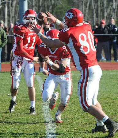 Topsfield:<br /> Masco's Ben Panunzio, left, throws the ball to Kurt Hunziker behind the line of scrimmage at the North Andover at Masconomet football game on Thanksgiving Day.<br /> Photo by Ken Yuszkus/Salem News, Thursday, November 24, 2011.