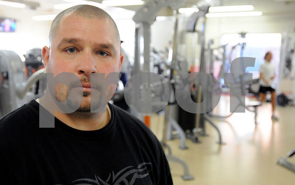 Salem:<br /> Bryan Brown stands in the weight room at the YMCA where he works out.<br /> Photo by Ken Yuszkus/Salem News, Wednesday December 3, 2008.