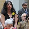 Boston:<br /> Kimberly Flynn of Peabody, stands as she is recognized during the Ninth Annual Unsung Heroines of Massachusetts program at the state house.<br /> Photo by Ken Yuszkus/Salem News, Wednesday, May 16, 2012.