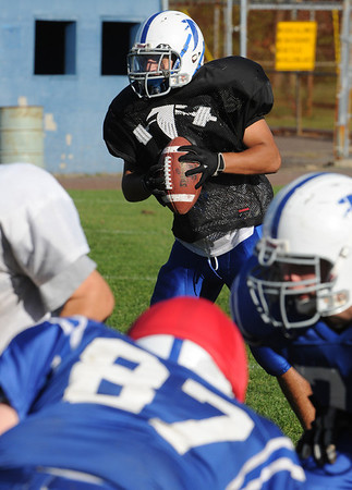 Danvers:<br /> Nick Valles with the ball is ready to throw at the Danvers High School football practice. The Danvers football team is getting ready for the upcoming Danvers-Beverly game Friday night,<br /> Photo by Ken Yuszkus/Salem News, Wednesday,  October 13, 2010.