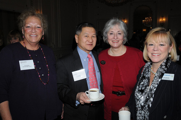 Beverly:<br /> From left, Gina Wallace of Beverly Main Street, Earl Kishida of Century Bank, Ilia Stacy, executive director of the Beverly Chamber of Commerce, and Jo Broderick of Montserrat College of Art, attend the Beverly Chamber of Commerce breakfast held at Tupper Manor on Friday morning.<br /> Photo by Ken Yuszkus/Salem News, Friday, January 14, 2011.
