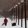Salem:<br /> Chris Minkiewicz walks her dog, Ariel, on the walkway which runs along Collins Cove in Salem on a wintery Wednesday morning.<br /> Photo by Ken Yuszkus/Salem News, Wednesday, February 2, 2011.