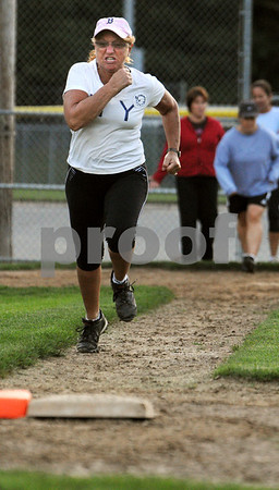 Beverly:<br /> Sue Carnevale runs to first base as fast as she can as part of a drill at the softball clinic at Harry Ball Field. The Beverly softball team is teaming up with mothers to teach them how to bat and throw a ball in preparation for the upcoming Momball fundraiser.<br /> Photo by Ken Yuszkus/Salem News, Tuesday, September 15, 2009.