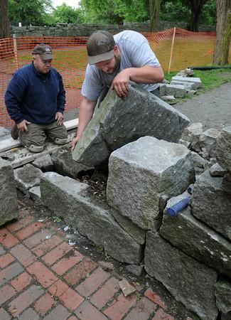 Salem:<br /> Hayden Hillsgrove, left, and Keith Doland work on restoring the Witch Trials Memorial in Salem.<br /> Photo by Ken Yuszkus/Salem News, Wednesday, June 6, 2012.