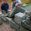 Salem:<br /> Hayden Hillsgrove, left, and Keith Doland work on restoring the Witch Trials Memorial in Salem.<br /> Photo by Ken Yuszkus/Salem News, Wednesday, June 6, 2012.