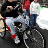 Salem:<br /> Eric Shairs sits on his hand bike with his two daughters, Cala, 10, and Presley, 6, standing near him. Eric Shairs, was paralyzed jumping into a pool 4 1/2 years ago.<br /> Photo by Ken Yuszkus/Salem News, Friday, January 15, 2010.