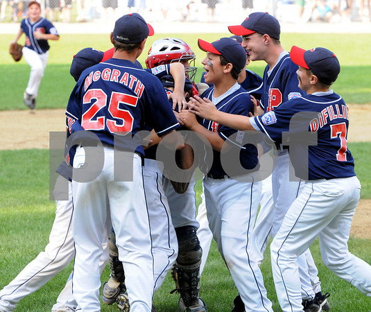 Beverly:<br /> Peabody West's pitcher Nick Bona and catcher Traverse Briana get swarmed by the team after they won the State Little League championship game of Peabody West vs Newton Central at Harry Ball Field.<br /> Photo by Ken Yuszkus/Salem News, Monday, August 3, 2009.