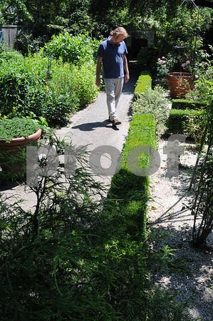 Salem:<br /> Jonathan Reardon walks down the pathway of his garden. Jonathan and Jen Reardon's Chestnut Street garden will be featured on the Salem Garden Club's Garden Tour on July 11 and 12.<br /> Photo by Ken Yuszkus/Salem News, Monday, July 6, 2009.