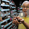 Ipswich:<br /> Peter Messelaar, of Messelaar Bulbs, holds some of the many flower bulbs that he sells in his store.<br /> Photo by Ken Yuszkus/Salem News, Wednesday, September 9, 2009.
