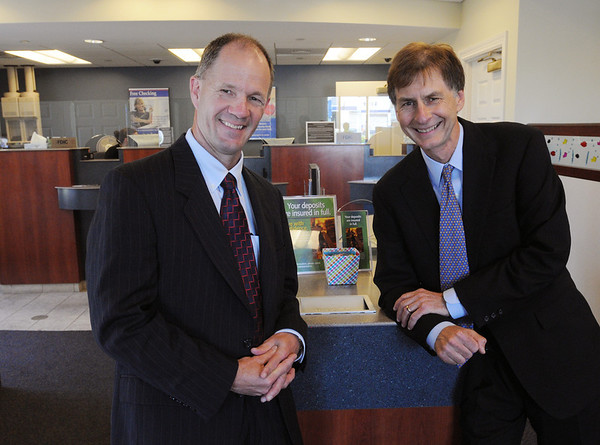 Peabody:<br /> Karl Wilson, left, and Peter Malinowski are commercial bankers at North Shore Bank.<br /> Photo by Ken Yuszkus/Salem News, Thursday, July 14, 2011.