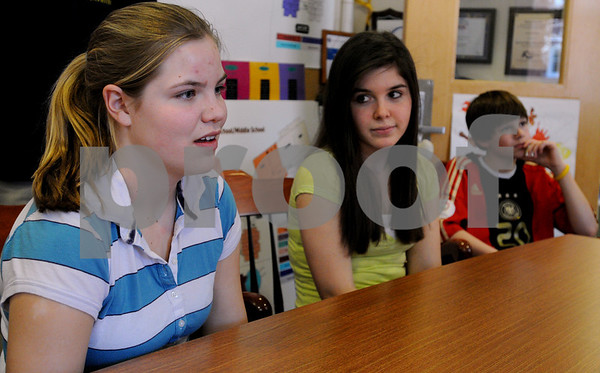 Ipswich:<br /> From left, Brigid O'Flynn, Jessy Lecha, and Owen Marsh, Ipswich Middle School students, talk about their upcoming 10-day trip to China.<br /> Photo by Ken Yuszkus/Salem News, Tuesday, April 14, 2009.
