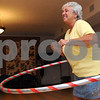 Ipswich:<br /> Sandy Noe exercises with her hula hoop during the weekly women's hula hoop session in the Senior Center in town hall.<br /> Photo by Ken Yuszkus/Salem News, Monday, August 10, 2009.
