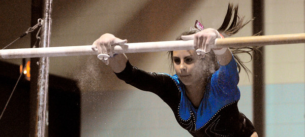 Peabody:<br /> Danvers' Roni Levine starts her routine on the uneven bars during the Danvers at Peabody girls gymnastics meet.<br /> Photo by Ken Yuszkus/Salem News, Monday, January 30, 2012.