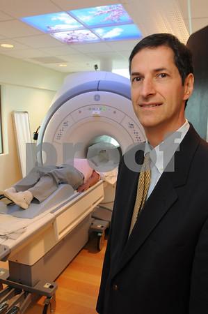 Danvers:<br /> Dr. Steven Defossez, medical director of Beverly Hospital at Danvers MRI Center stands near the 3T machine at the hospital.<br /> Photo by Ken Yuszkus/Salem News/ Tuesday September 16, 2008.
