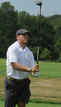 Middleton:<br /> Shawn Thornton of the Boston Bruins watches as his ball travels down the fairway after teeing off the first tee during the Putts and Punches For Parkinson's golf tournament at the Ferncroft Country Club.<br /> Photo by Ken Yuszkus/Salem News, Monday August 9, 2010.
