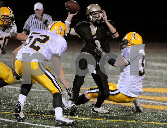 Peabody:<br /> Bishop Fenwick's Chris Renzulli gets sacked by Arlington Catholic's defense in the second quarter of the football game. Arlington Catholic played Bishop Fenwick at Bishop Fenwick.<br /> Photo by Ken Yuszkus/Salem News, Friday, October 31, 2008.
