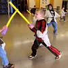 Peabody:<br /> Logan Tracia, left, and Will Perillo are engaged in a lightsaber duel with their training lightsabers. They learned what it took to be a Jedi Knight at the Higgins Middle School Cafeteria during a Peabody Rec. Dept. program on Tuesday morning during school vacation week. Also, they designied and made their own recycled Droid, made a Training  Lightsaber, and had their photo taken as a Jedi.<br /> Photo by Ken Yuszkus/Salem News, Tuesday, April 19, 2011.
