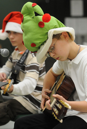 Salem:<br /> Jake Craven, left, and Cole Jermyn play guitars during their presentation as part of the winter concert at the Salem Academy Charter School. This was Salem Academy Charter School's first ever winter concert. The school got a grant from the Music Drives Us Foundation last year which enabled them to hire a music teacher and start a music program.<br /> Photo by Ken Yuszkus/Salem News, Thursday, December 17, 2009.